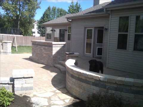 natural stone patio with retaining wall