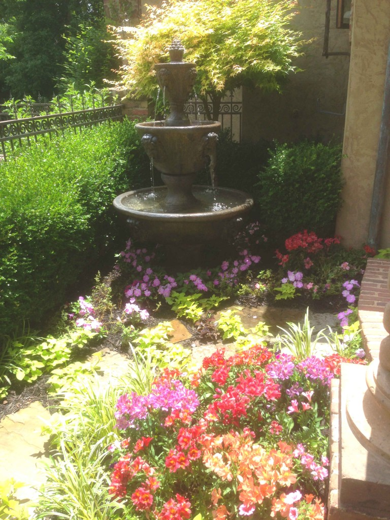 small garden area with fountain