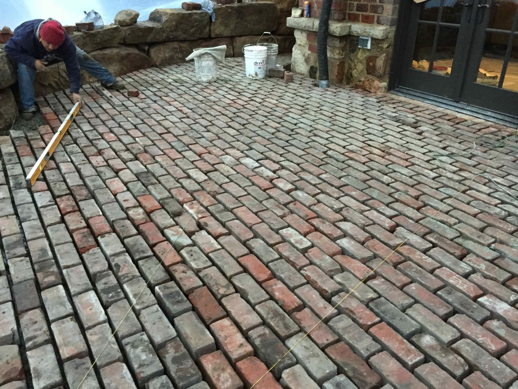 laying the bricks for a patio
