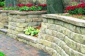 garden wall above stonework patio